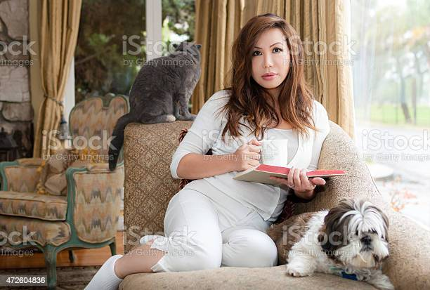 Woman relaxing with pets book and coffee in her home picture id472604836?b=1&k=6&m=472604836&s=612x612&h= ee93kavjsjoaworphx6ld6i9zlnmctq7j0jtphsfkq=