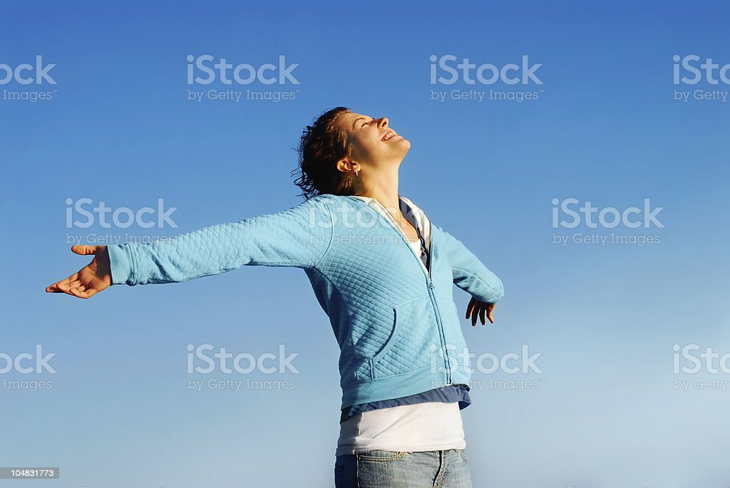 Woman relaxing with stretched arms royalty-free stock photo