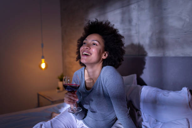 Woman relaxing with the glass of wine stock photo