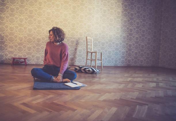 woman relaxing with yoga at home - showus стоковые фото и изображения