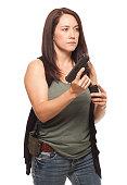 istock Woman reloading her gun on white background. 479323190