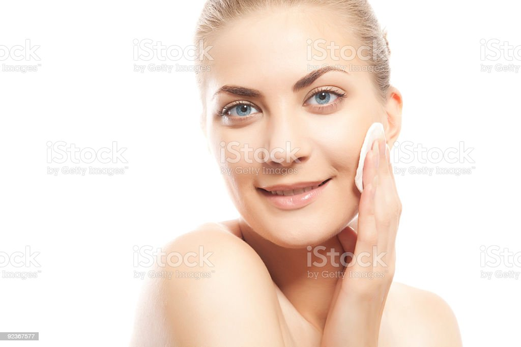 Woman Removing Make Up and smiling royalty-free stock photo