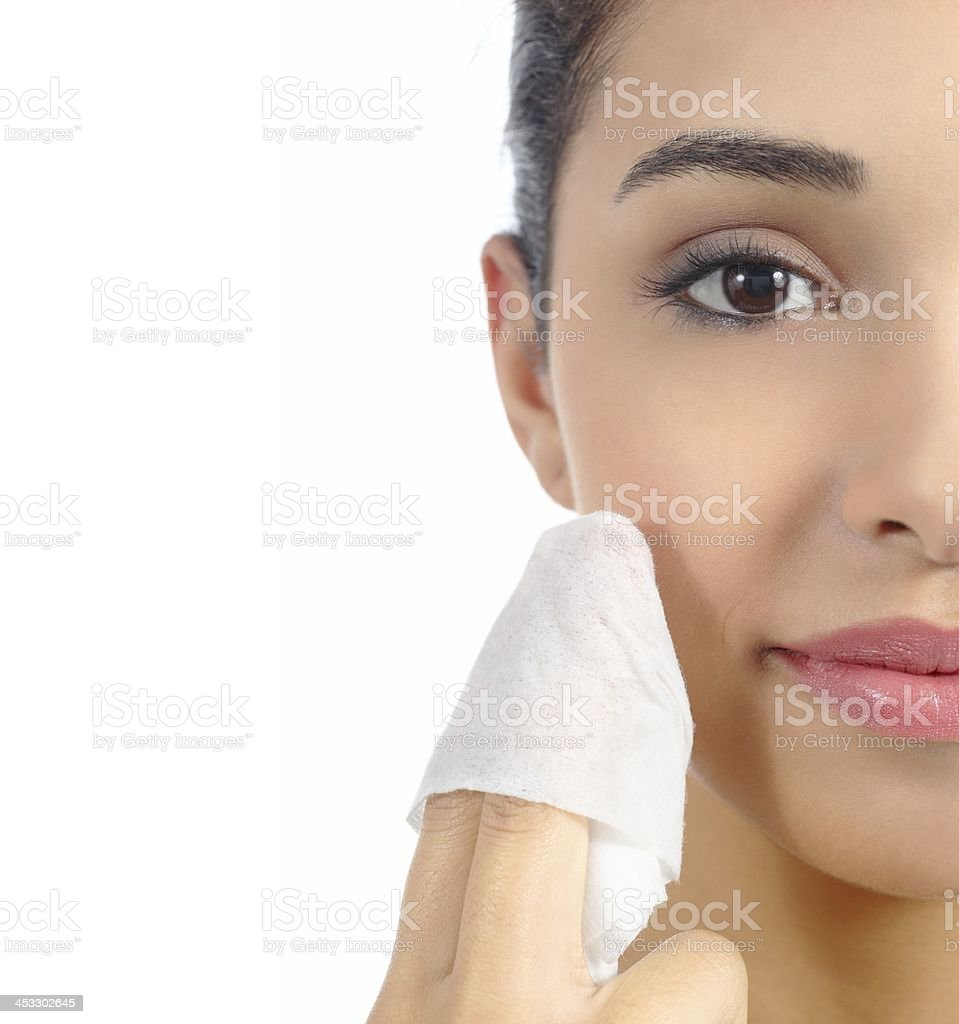 Woman removing make up with facial wipe stock photo
