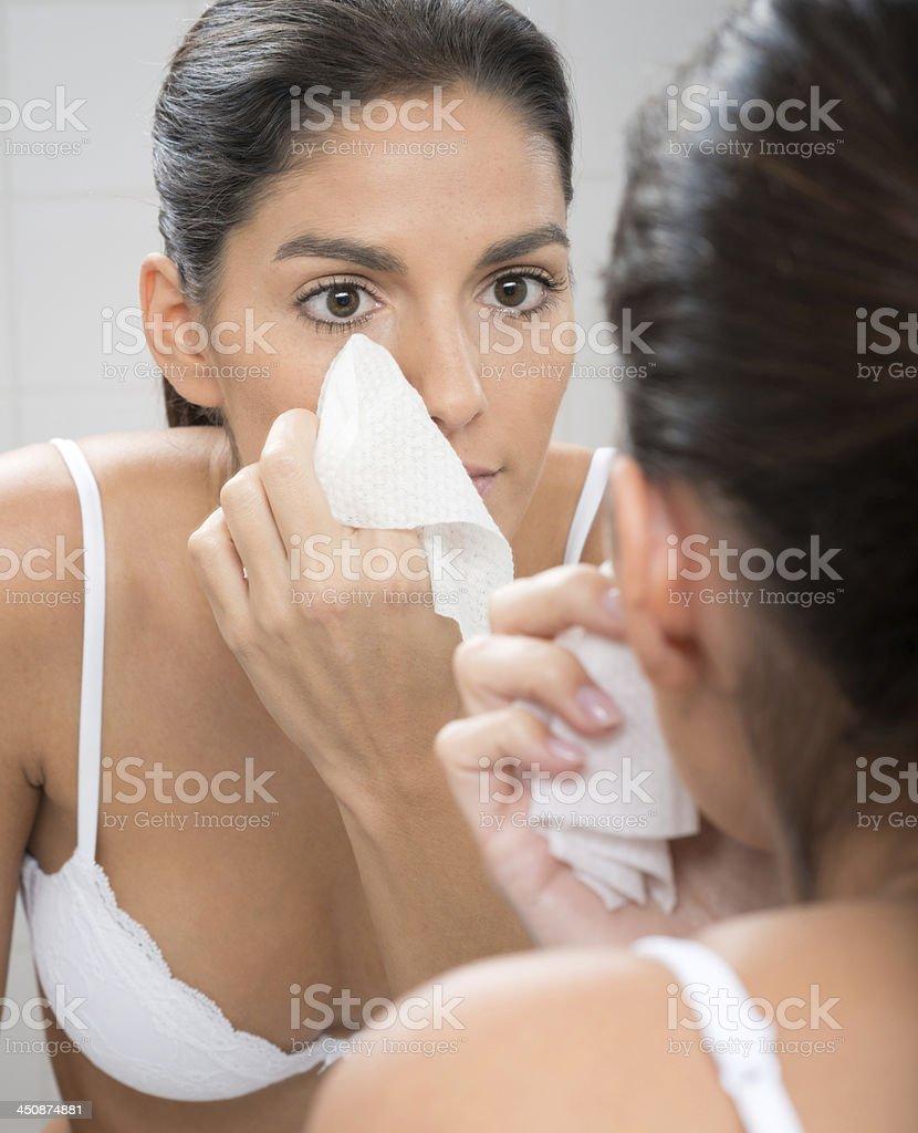 Woman removing Make-Up stock photo