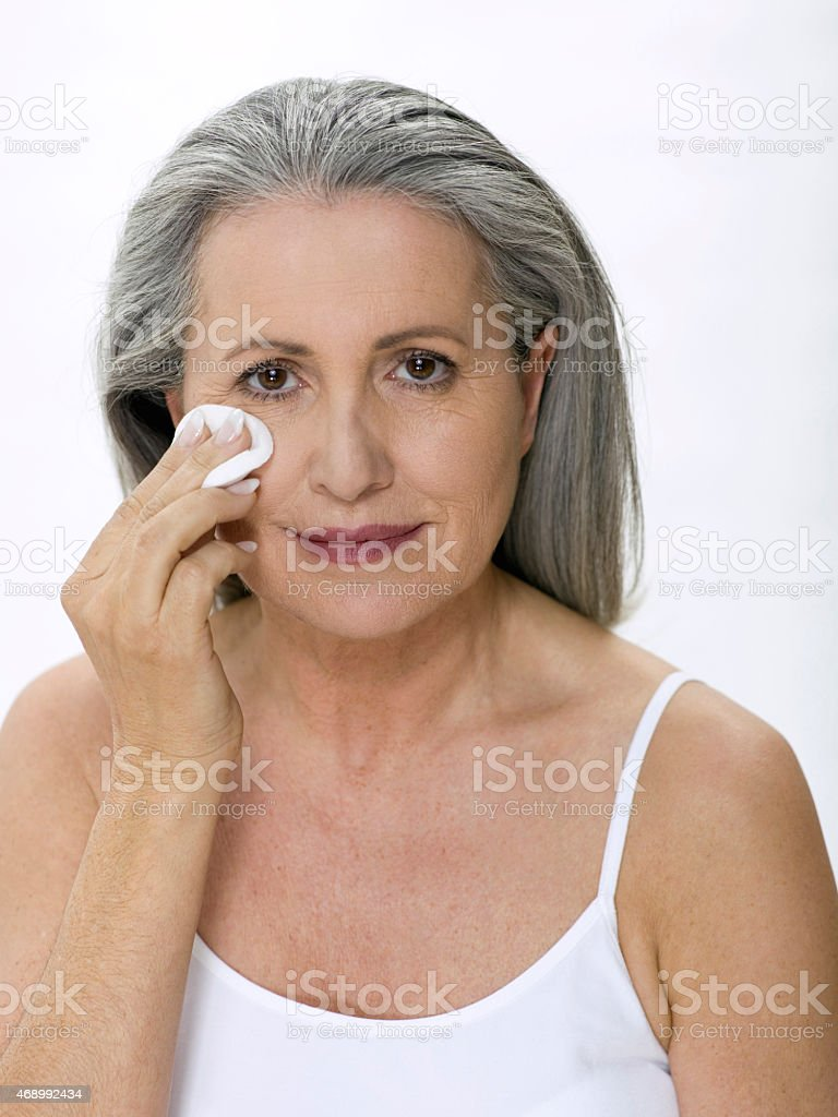 Woman removing makeup stock photo