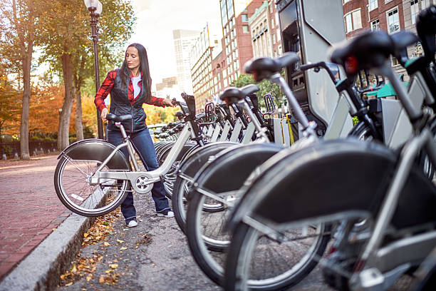 Woman renting a bicycle stock photo