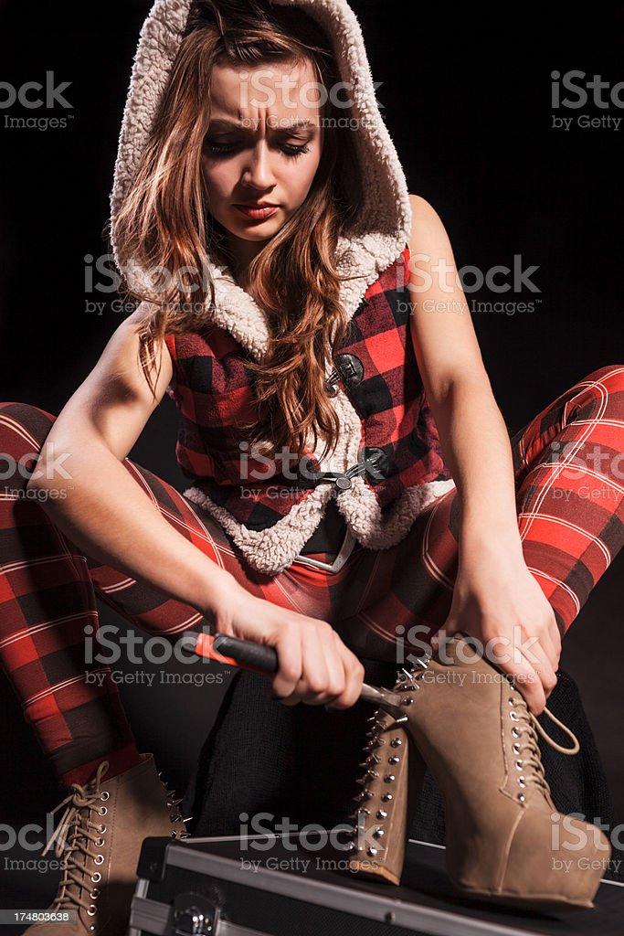 Woman repair boots royalty-free stock photo