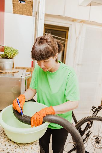 woman repairing a flat tire