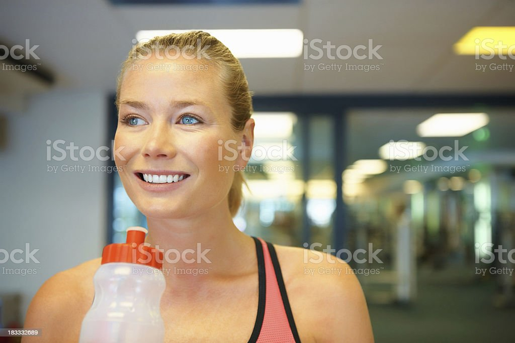 Woman replenishing her fluids royalty-free stock photo