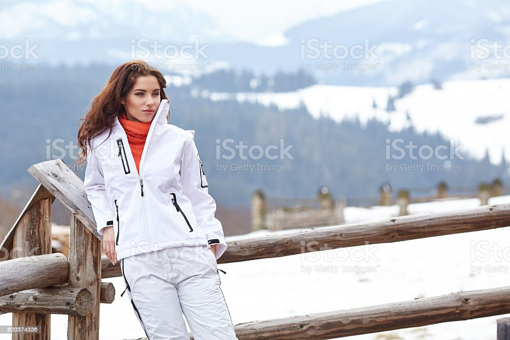 woman resting after a winter sports on the terrace of foto de stock royalty-free