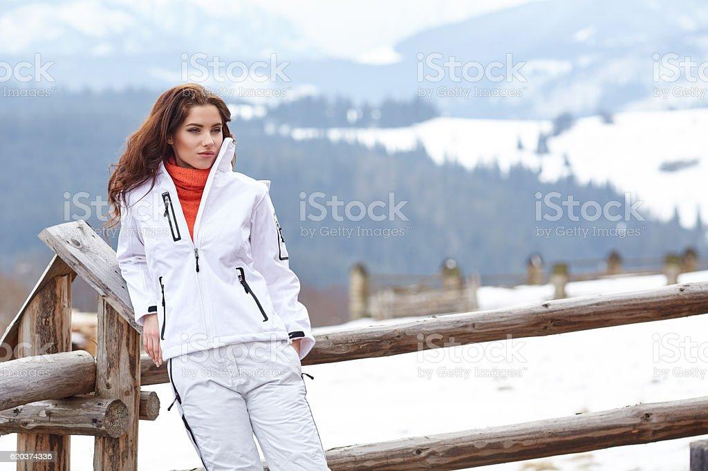woman resting after a winter sports on the terrace of zbiór zdjęć royalty-free