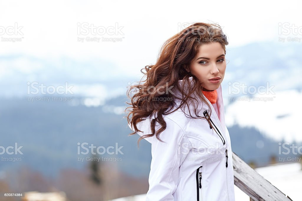 woman resting after a winter sports on the terrace of zbiór zdjęć royalty-free