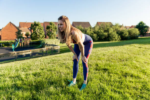 Woman Resting After Running at the Park stock photo