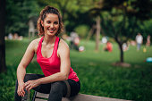 Woman resting after running in the park