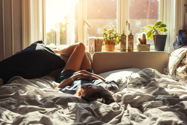 Woman resting at home stock photo