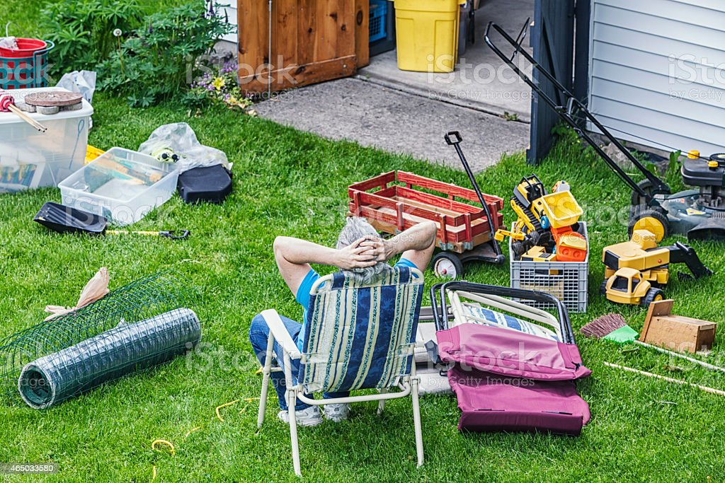 Woman Resting During Spring Cleaning stock photo