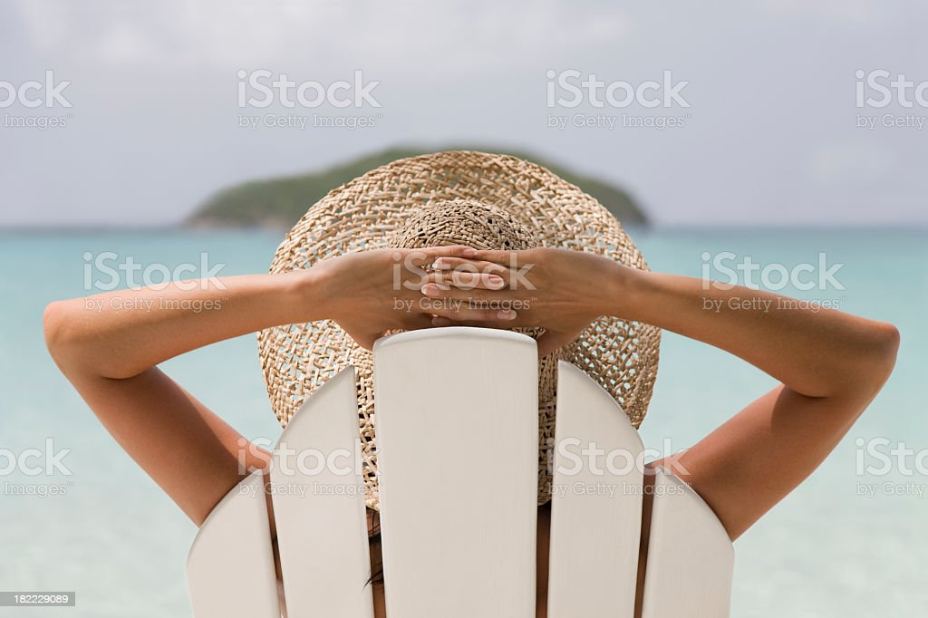 woman resting in a chair stock photo