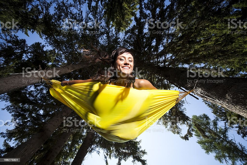 Woman resting in an hammock royalty-free stock photo