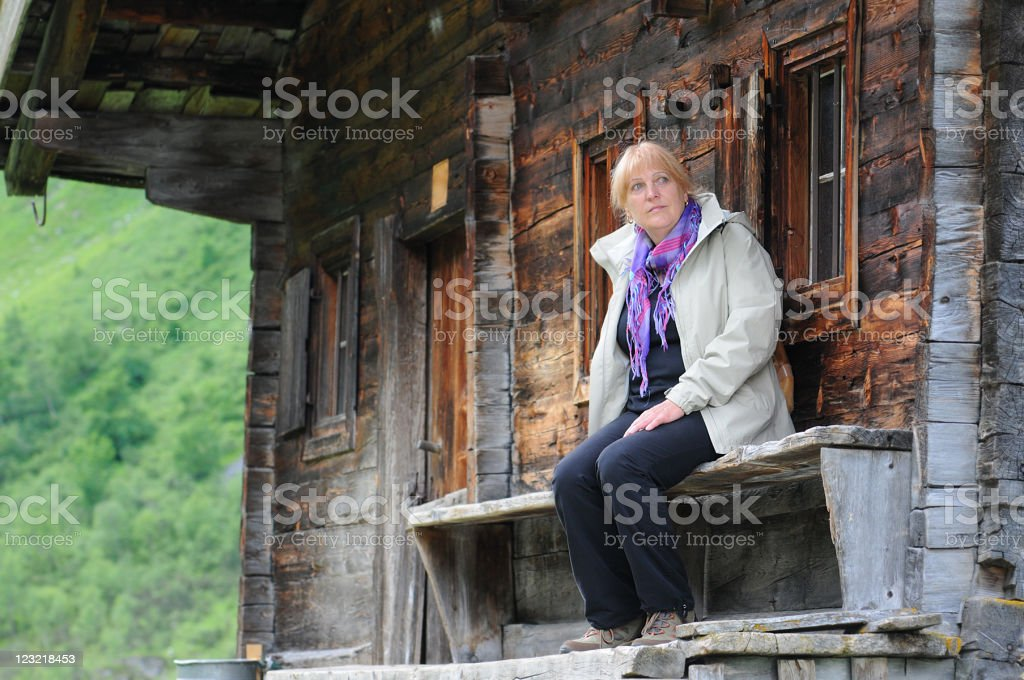 woman resting in front of barn royalty-free stock photo