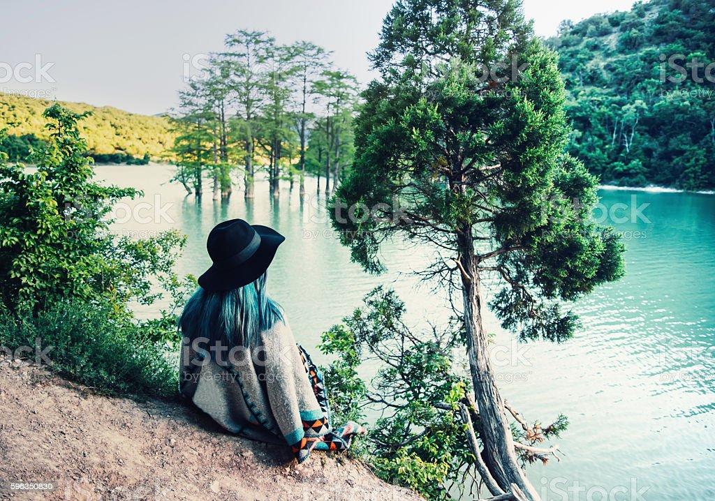 Woman resting near the lake Lizenzfreies stock-foto