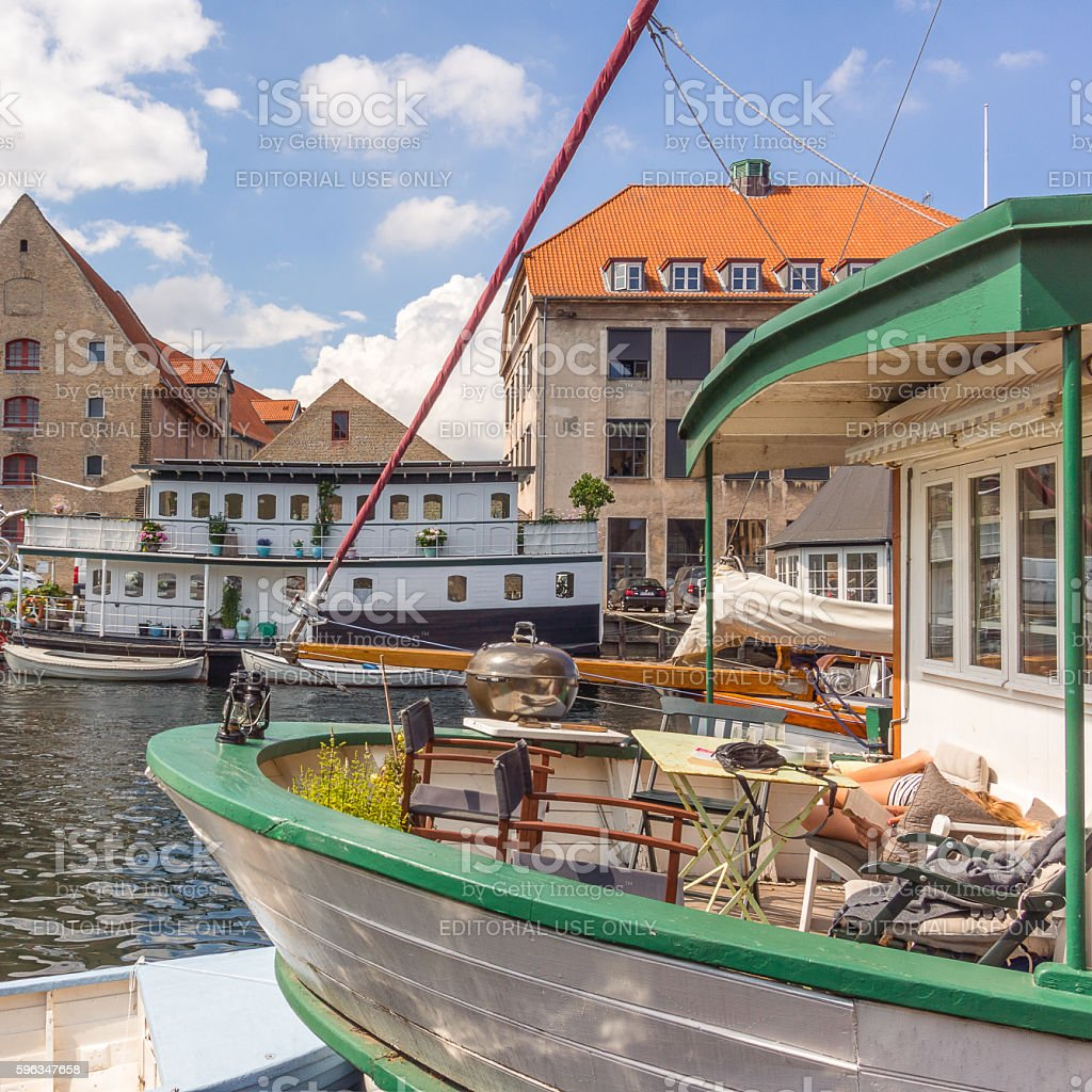 Woman resting on a houseboat in Copenhagen harbor royalty-free stock photo