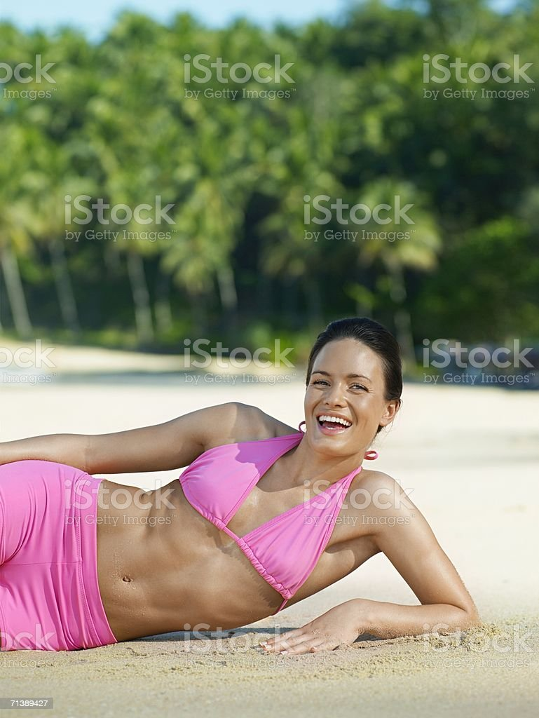 Woman resting on a sandy beach royalty-free stock photo