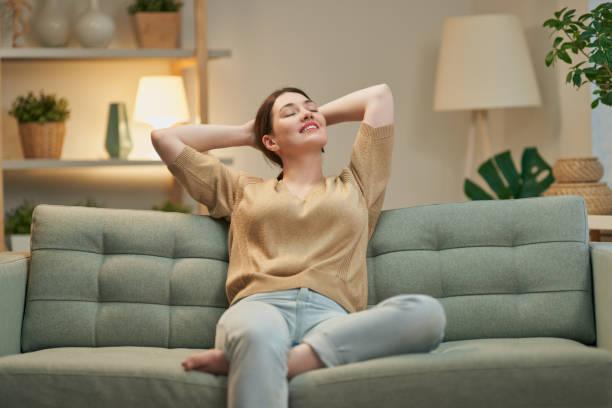 woman resting on sofa stock photo