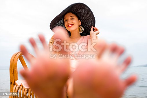476618818 istock photo Woman resting on the beach 476619950