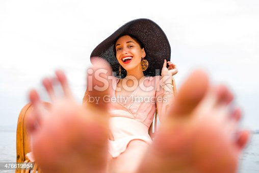 476618818 istock photo Woman resting on the beach 476619954