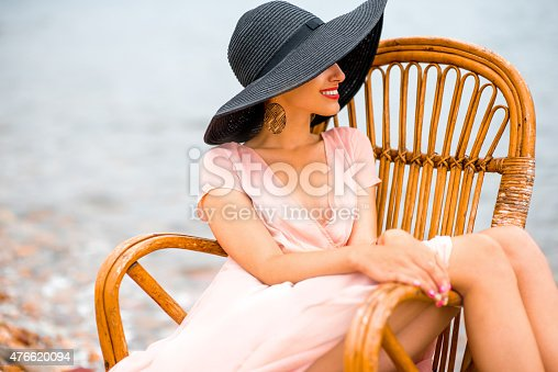 476618818 istock photo Woman resting on the beach 476620094
