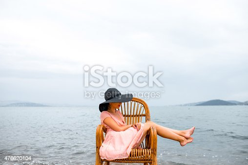 476618818 istock photo Woman resting on the beach 476620104