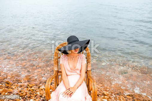 476618818 istock photo Woman resting on the beach 476620120
