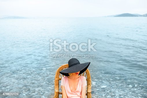 476618818 istock photo Woman resting on the beach 476620124