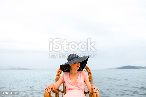 476618818 istock photo Woman resting on the beach 476620128