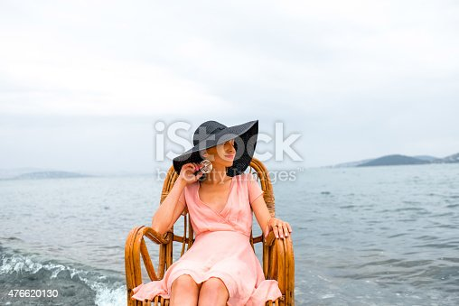 476618818 istock photo Woman resting on the beach 476620130