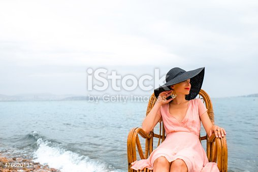 476618818 istock photo Woman resting on the beach 476620132