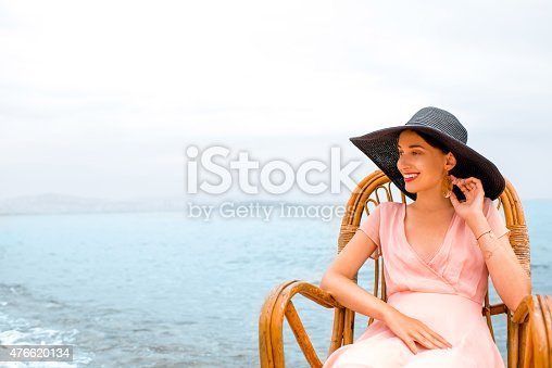 476618818 istock photo Woman resting on the beach 476620134
