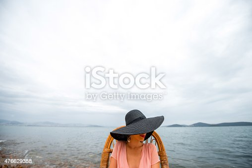 476618818 istock photo Woman resting on the beach 476629388