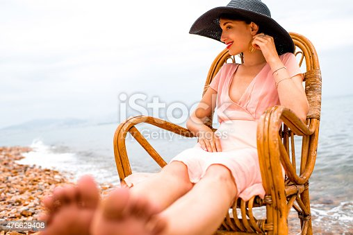 476618818 istock photo Woman resting on the beach 476629408