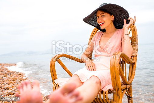 476618818 istock photo Woman resting on the beach 476629428