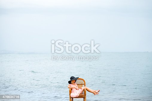 istock Woman resting on the beach 476634716