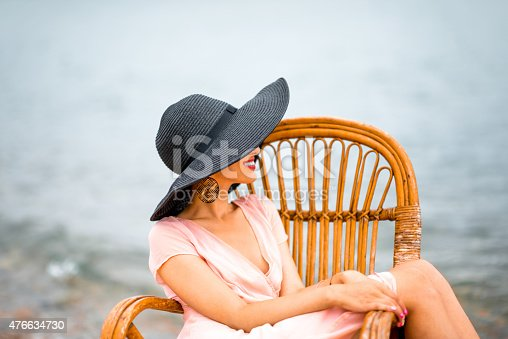 476618818 istock photo Woman resting on the beach 476634730