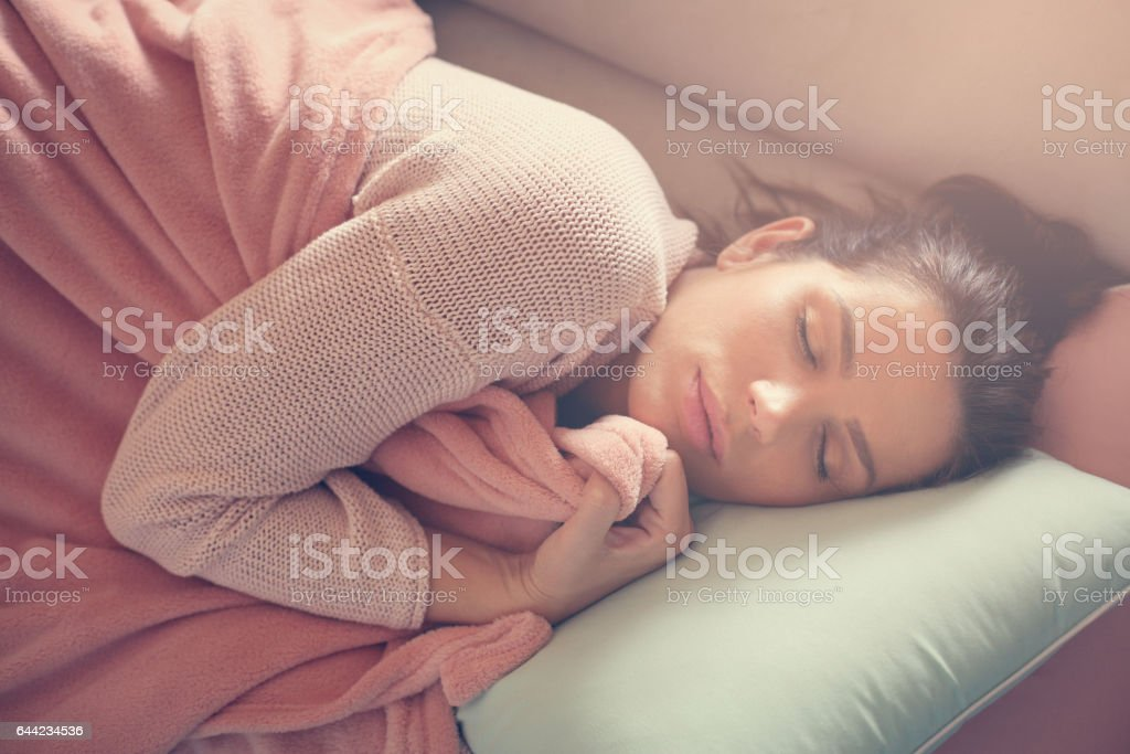 Woman resting on the couch. stock photo