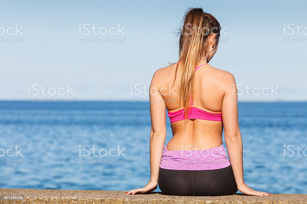 Woman resting relaxing after doing sports outdoors stock photo