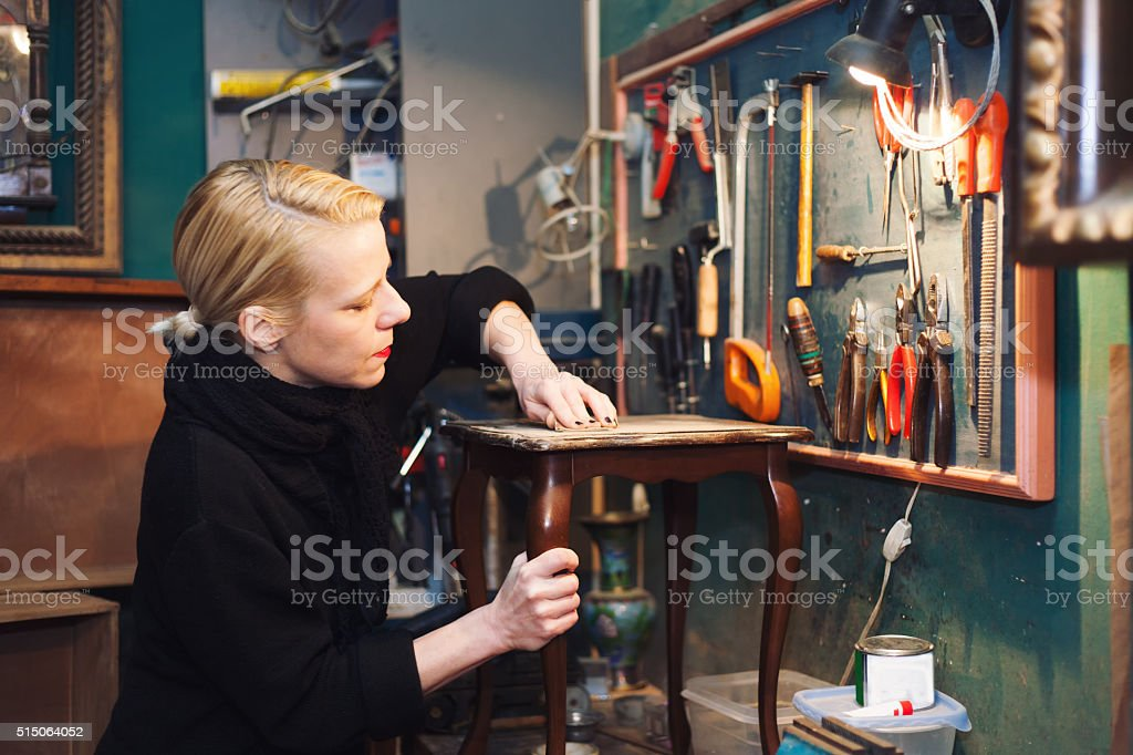 woman restoring table stock photo