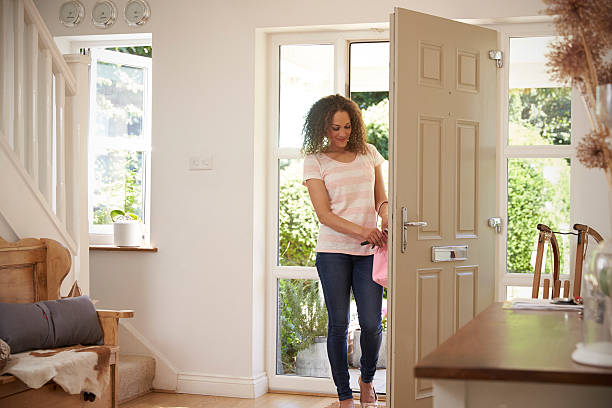Woman Returning Home And Opening Front Door – Foto