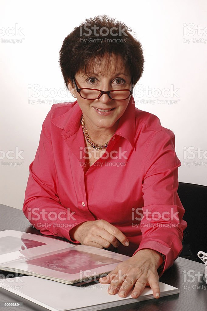 woman reviewing book 2093 royalty-free stock photo