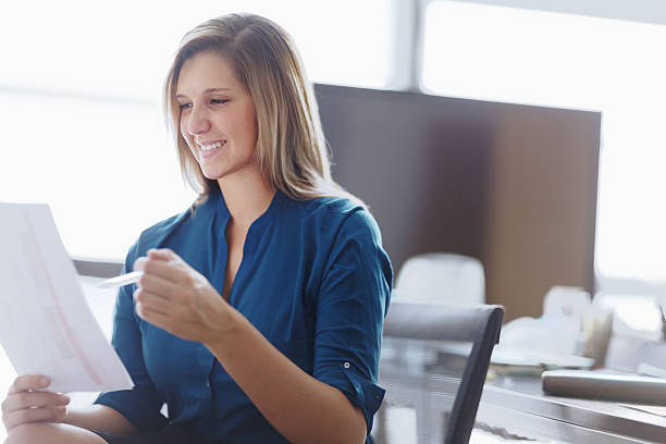 Woman reviewing document in studio office – Foto