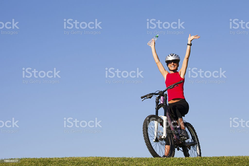 Woman ridding her bike royalty-free stock photo