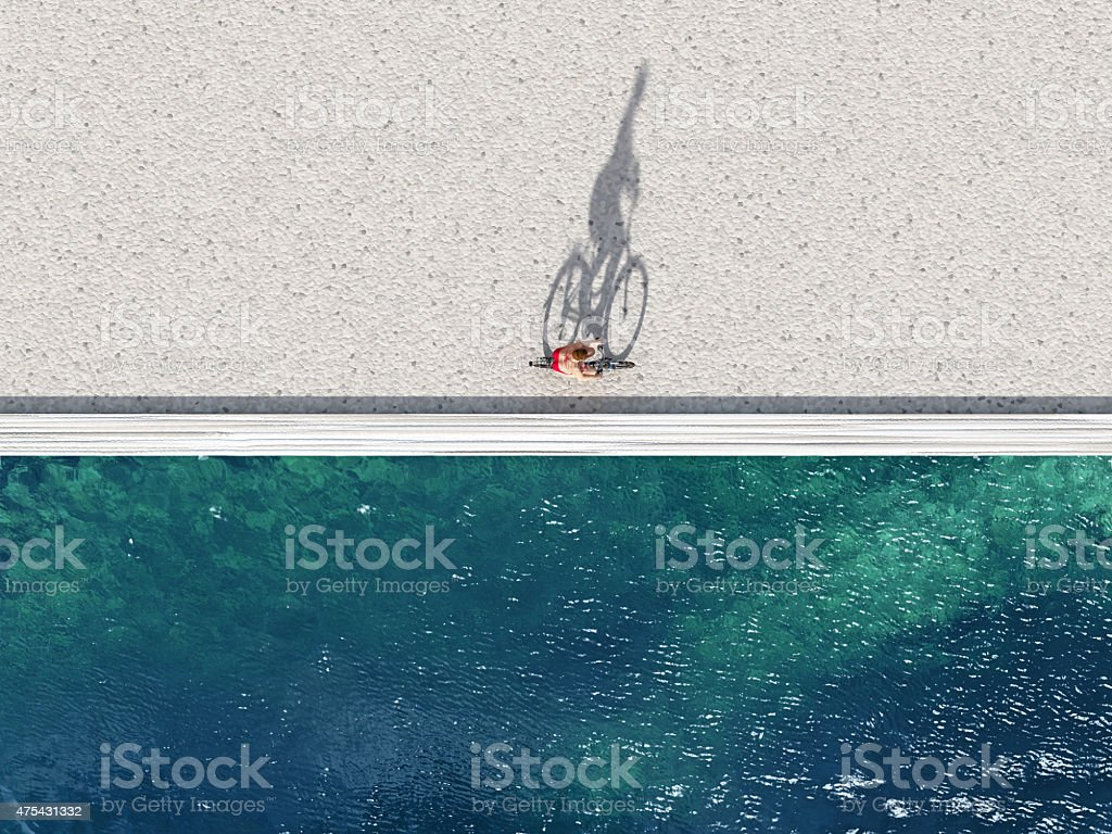 woman ride on bike on summer beach stock photo